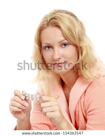 A woman with pills, isolated on white - stock photo
