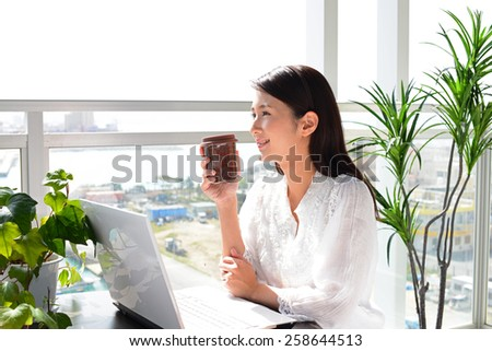 A woman working on the computer - stock photo