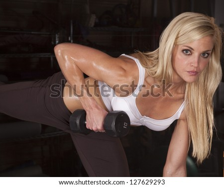 A woman working out with weights in a gym. - stock photo
