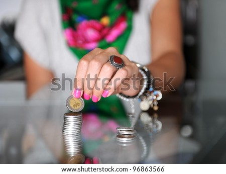 A women counting money on a disk, with Egyptian local currency - stock photo