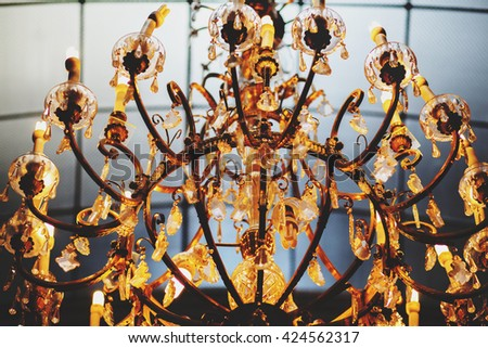 A wonderful old gold vintage chandelier decorated with crystals - stock photo
