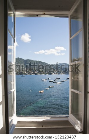 a wonderful view from the opened window to the sea - stock photo