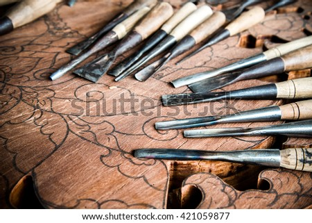 a wood carvings, tools and processes work. - stock photo
