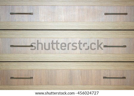 A wood chest iron handle close up at the day light. - stock photo