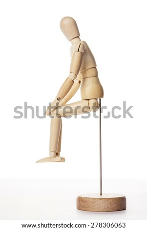 A wood doll sit down the chair isolated white background in the studio. - stock photo