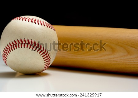 A wooden baseball bat and ball - stock photo