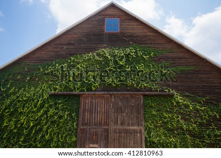 A wooden farm shed/ wooden barn and blue sky  - stock photo