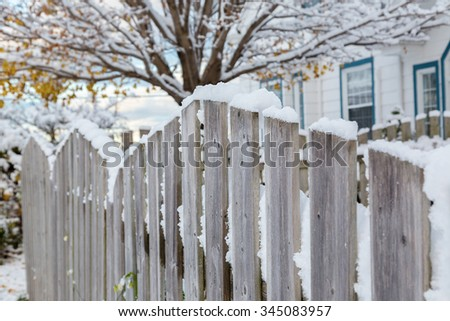 A wooden fence around a residential home's back yard. - stock photo