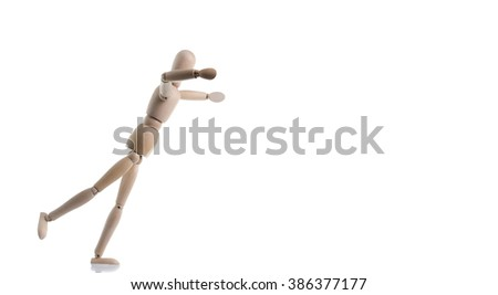 A wooden figure is tripping and falling, isolated on white. - stock photo