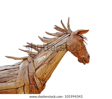 A wooden horse isolated against white. - stock photo