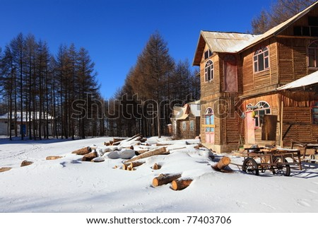 A wooden house in a snowy forest - stock photo
