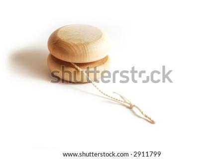 a wooden isolated yo-yo - stock photo