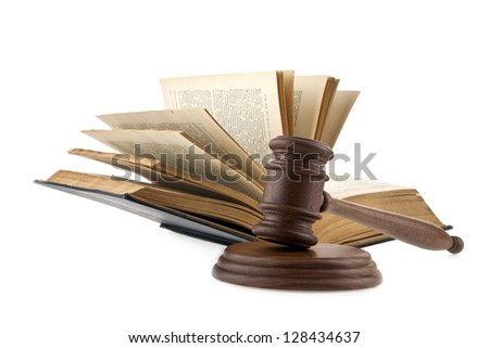 a wooden mallet and a book on a white background - stock photo