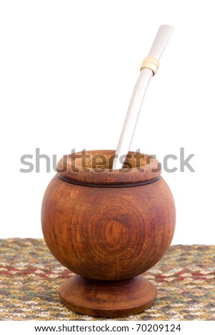 A wooden mate cup with bomba/bombija, from Argentina. - stock photo