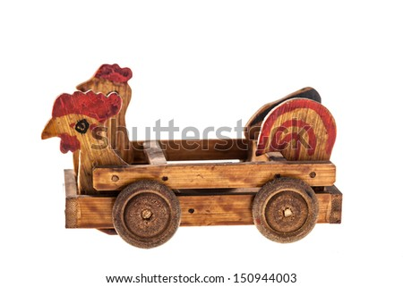 a wooden old toy car isolated over a white background - stock photo