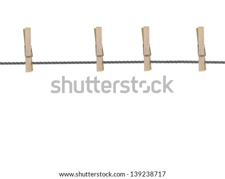 A wooden peg isolated against a white background - stock photo