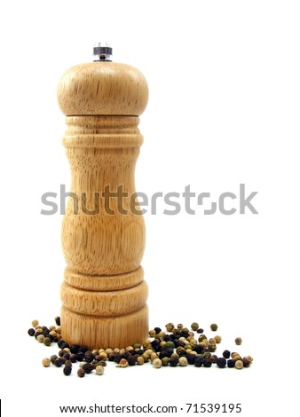 A wooden peppermill with peppercorns on white background - stock photo