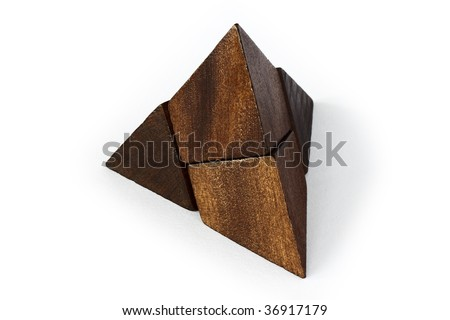 A wooden puzzle on an white background - stock photo