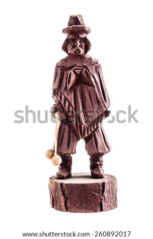 a wooden statuette of a gaucho isolated over a white background - stock photo