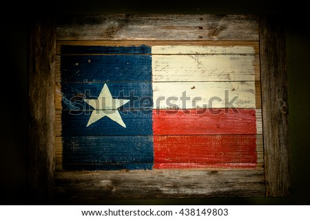 A wooden Texas flag with a white star, red, white background and red background made of pallet wood.  - stock photo