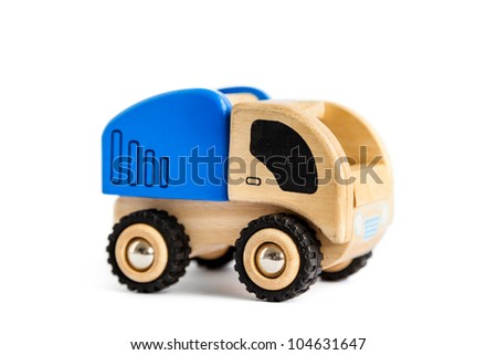 A wooden toy truck isolated on white - stock photo