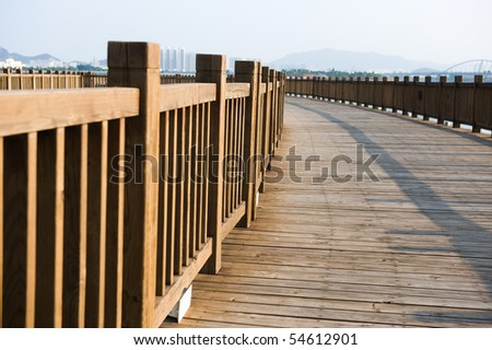 A wooden walkway on seaside. - stock photo