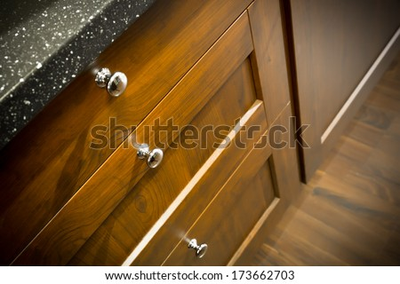 a wooden wardrobe drawer front, metal handle - stock photo