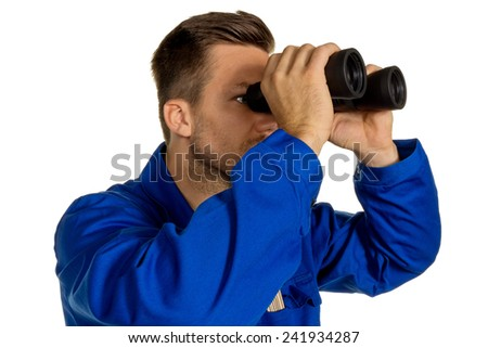 a worker in an industrial enterprise (craftsmen) with binoculars looking for jobs or jobs - stock photo