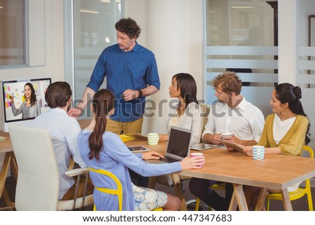 A worker team is doing a video conference at work - stock photo