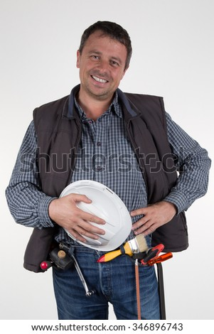 A worker with helmet and  tools isolated on white - stock photo