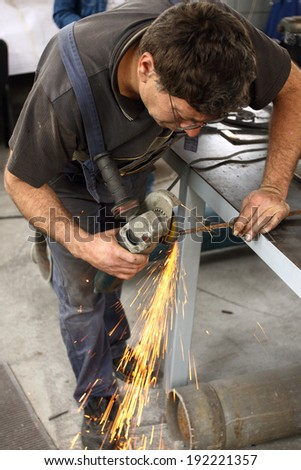 a worker working with Angle Grinder - stock photo