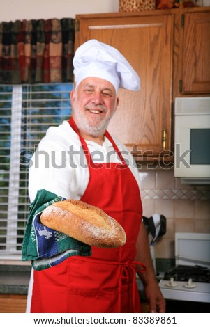 a world famous chef prepares one of his famous dishes for someone while in his kitchen at a world famous bed and breakfast hotel restaurant. - stock photo