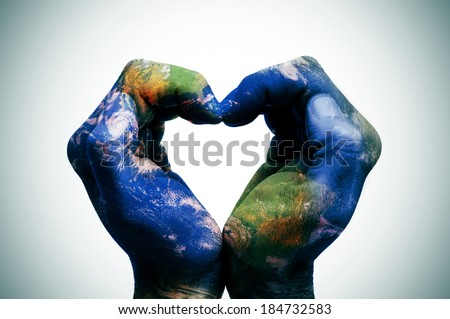 a world map in man hands forming a heart (Earth map furnished by NASA) - stock photo