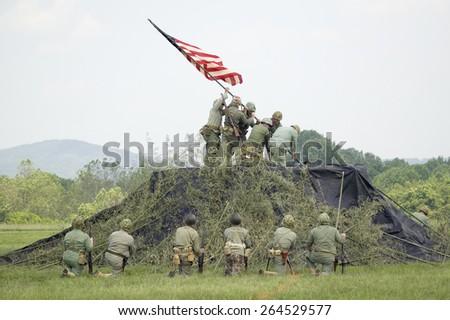 A World War II reenactment of US Marines raising the American flag on Iwo Jima on February 23, 1945 at Mid-Atlantic Air Museum World War II Weekend and Reenactment in Reading, PA held June 18, 2008 - stock photo