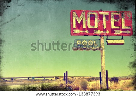 A worn vintage photo of an abandoned motel in Arizona. - stock photo