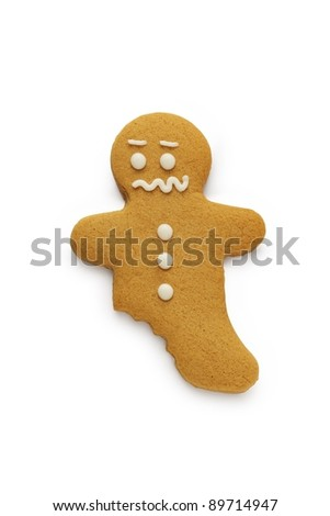 A worried looking gingerbread man - stock photo