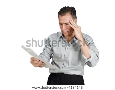 A worried man holding several envelopes in his hand (isolated ) - stock photo
