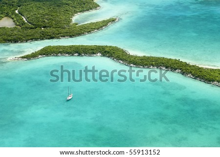 A yacht enjoying an amazing caribbean scene all by itself. The beautiful Bahamas. - stock photo