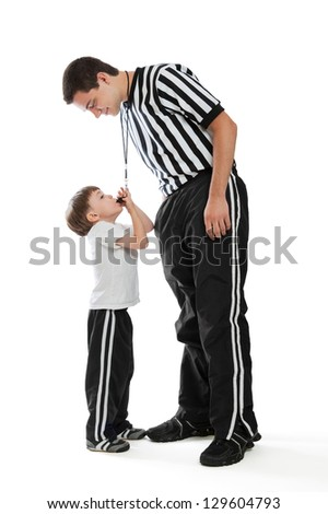 A 4 year old boy blowing teen referee's whistle isolated on a white background - stock photo