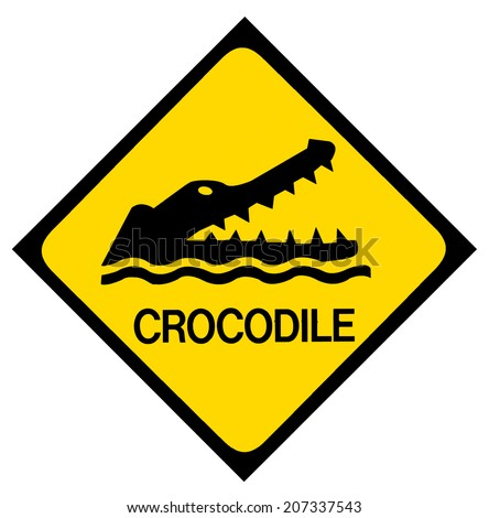 A yellow and black crocodile warning sign. Isolated on white. - stock photo