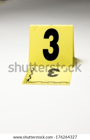 A yellow crime scene marker. - stock photo