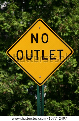 A yellow diamond shaped sign reading No Outlet - stock photo
