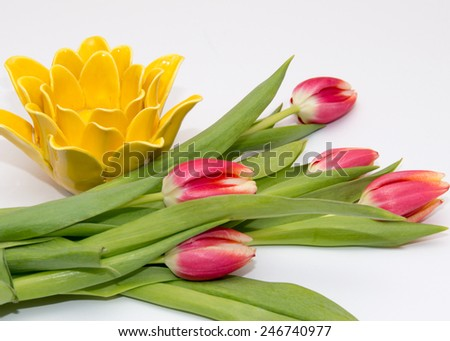 A yellow flower decoration with live tulips - stock photo