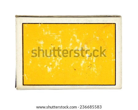 A yellow grungy matchstick box with blank space for text, isolated against white.  - stock photo