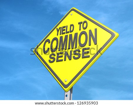 "A yield road sign with ""Yield to Common Sense""on a blue sky Background. - stock photo"
