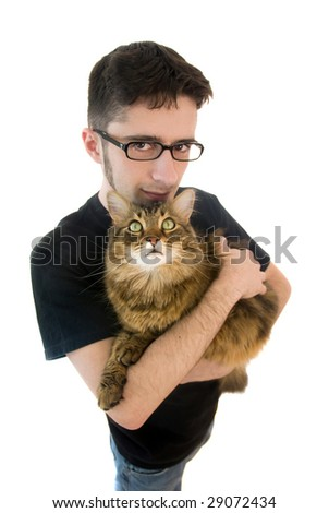 A young adult man on isolated white background holding his big maine coon cat - stock photo