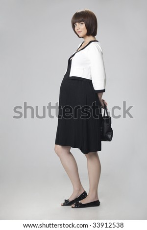 A young adult pregnant about 8 months - stock photo