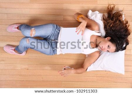 A young adult woman sleeping after reading a book. - stock photo