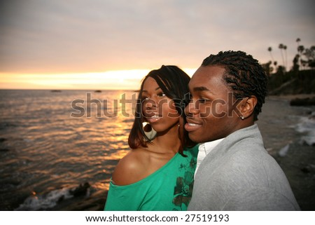 a young african american are shocked at what they see in the ocean - stock photo