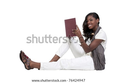 A young African American teenage woman reading a book - stock photo
